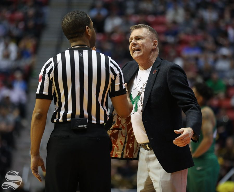 Marshall head coach Dan DAntoni argues with a ref during the First Round game of the NCAA men's college basketball tournament in San Diego.
