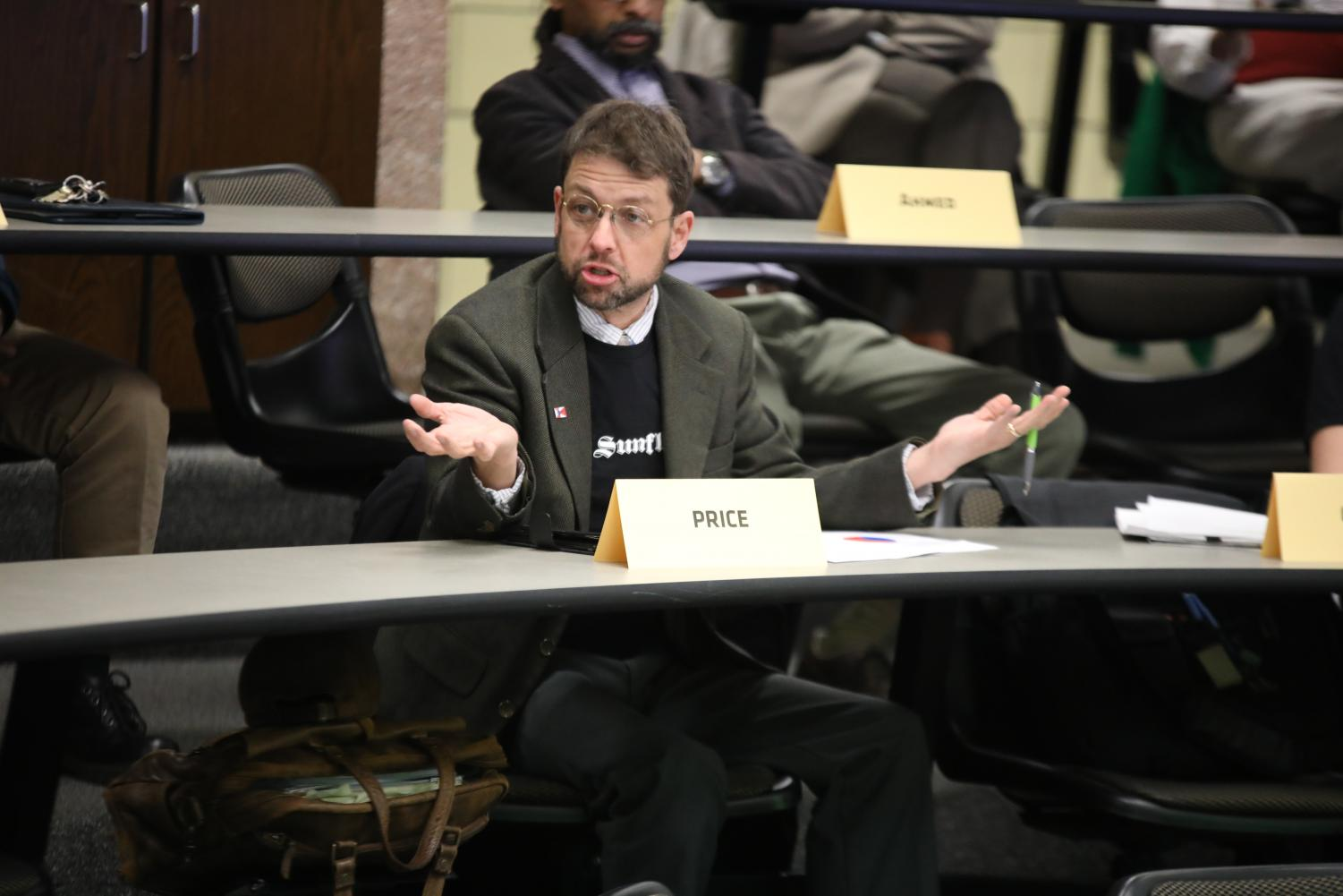 Jay Price speaks at a Faculty Senate meeting in March. Price, a humanities senator, said