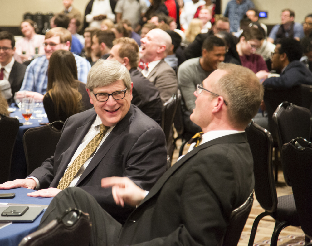 Lee Thompson (left), one of the debaters that won the National Debate Tournament for WSU 50 years ago, laughs with Jeff Jarman during the NDT award ceremony at the Marriott.
