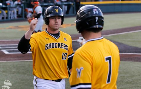 Wichita State's Paxton Wallace celebrates after scoring against Oklahoma State on April 4, 2018 at Eck Stadium.