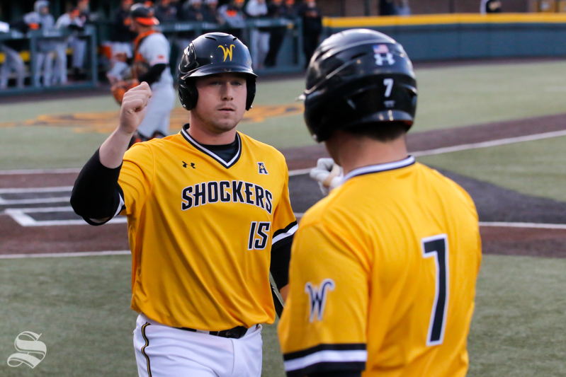 Wichita+State%27s+Paxton+Wallace+celebrates+after+scoring+against+Oklahoma+State+on+April+4%2C+2018+at+Eck+Stadium.