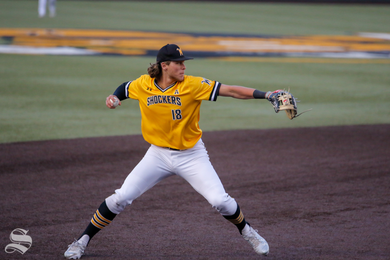 Wichita+State%27s+Alec+Bohm+throws+to+first+against+Oklahoma+State+on+April+4%2C+2018+at+Eck+Stadium.