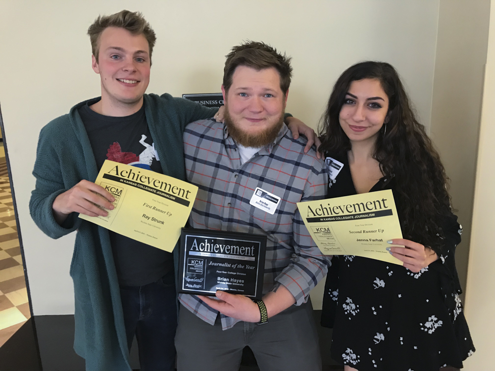 Ray Strunk, Brian Hayes, and Jenna Farhat who won second, first, and third, respectively, pose for a photo after winning the Kansas Collegiate Journalist of the Year competition.