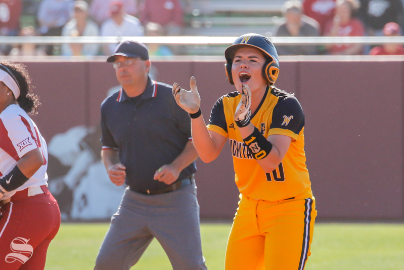 April 11, 2018: Wichita State's Mackenzie Wright celebrates her stolen base during their game against OU at Marita Hynes Field on April 11, 2018.