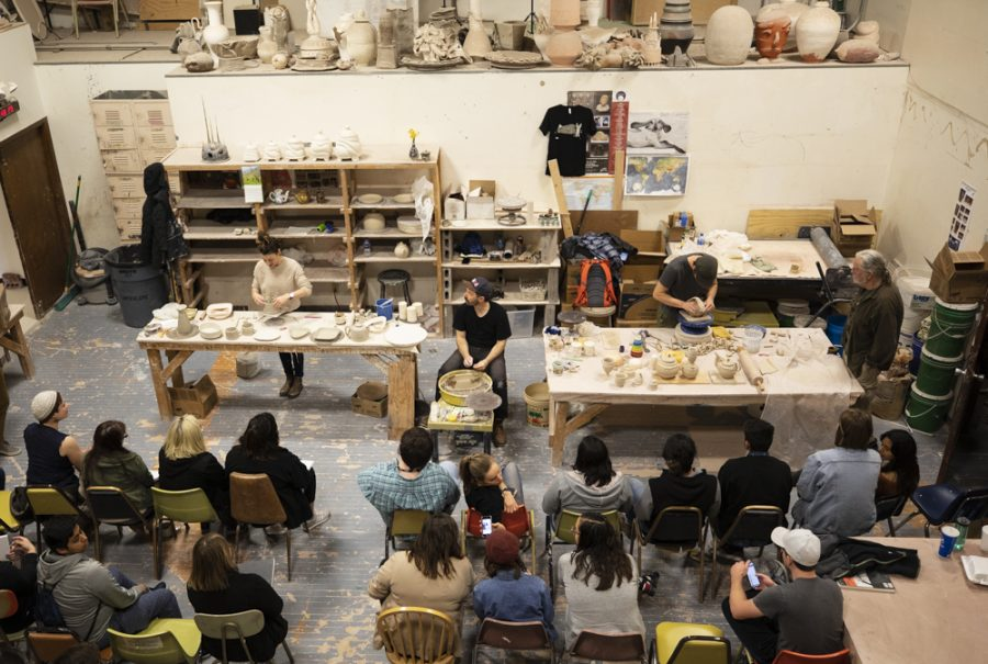 Molly Berger, John Cohorst and Justin Donofrio demo pottery techniques for students from local high schools and WSU students in Henrion Hall.