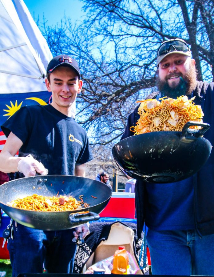 Senior Frank Kutilek (Left) and Sophomore Forrest Mayfield whip up a batch of Japanese Yakisoba during Inter-Fest on Tuesday afternoon. The two were one of many who publicly prepared and served dishes to attendees.