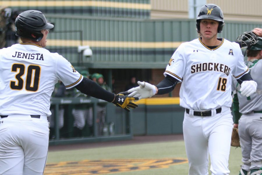 Wichita State's Alec Bohm celebrates scoring against Tulane in the first game of the series Friday afternoon.