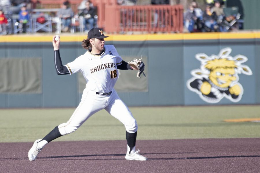 Wichita+State+junior+Alec+Bohm+throws+to+first+in+the+game+against+KU+Wednesday+evening+at+Eck+Stadium.