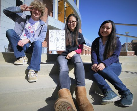Representatives from left to right: Davis Peck, Irena Kutilek and  Akari Yoshioka. Kutilek brandishes a sign encouraging students to stop by Japan Festival on Wednesday April 21 at the RSC.