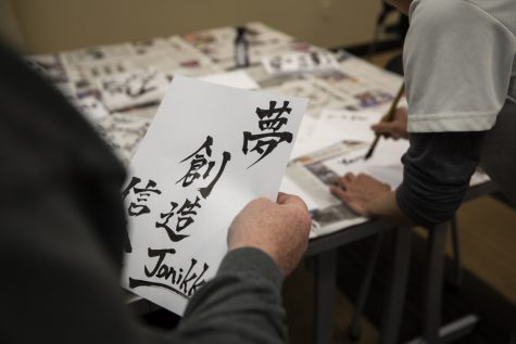 Guest got phrases and their names in Japanese calligraphy at the annual Japan Festival