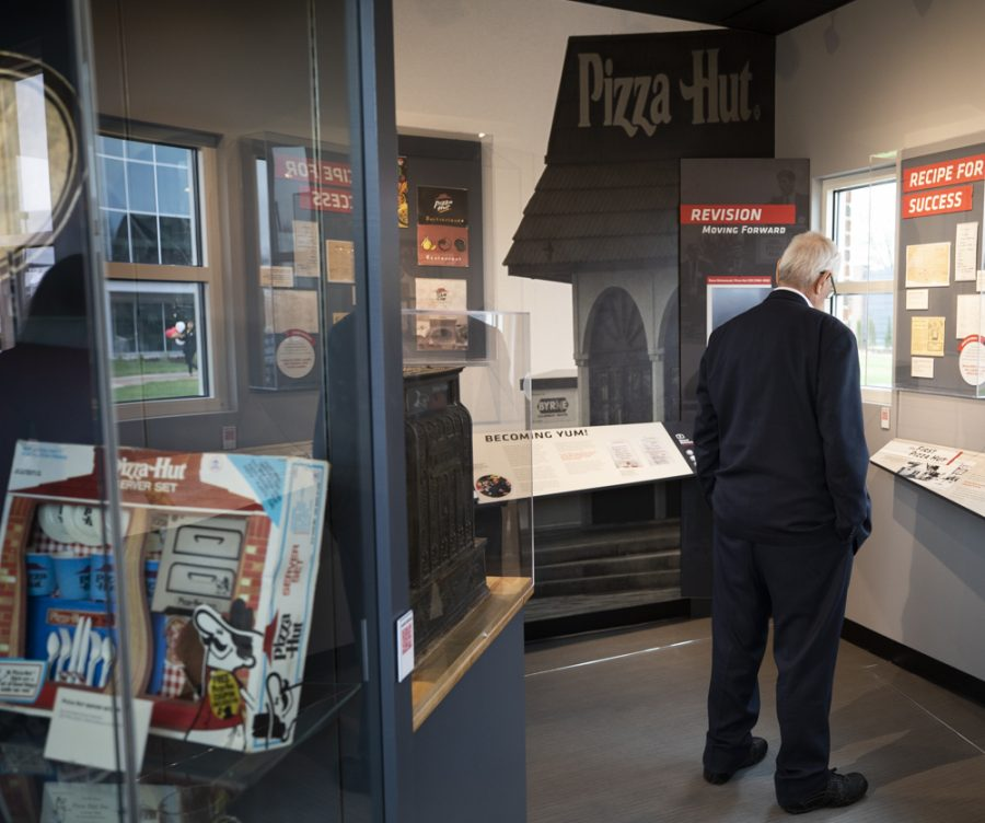 President John Bardo looks at exhibits during the Pizza Hut Museum grand opening.