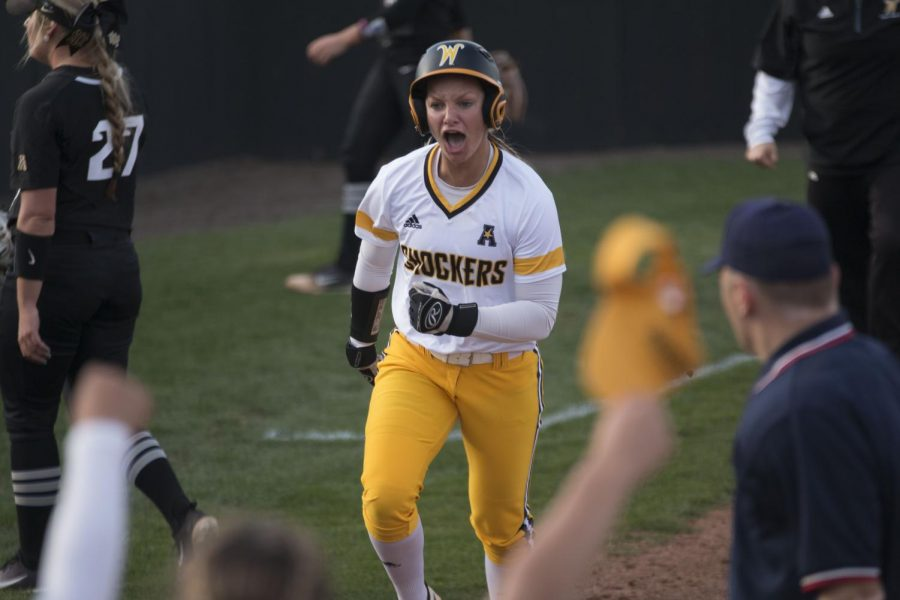 Wichita+State+junior+Bailey+Lange+runs+for+home+plate+in+the+last+inning+of+the+first+game+against+UCF+Friday+evening.+