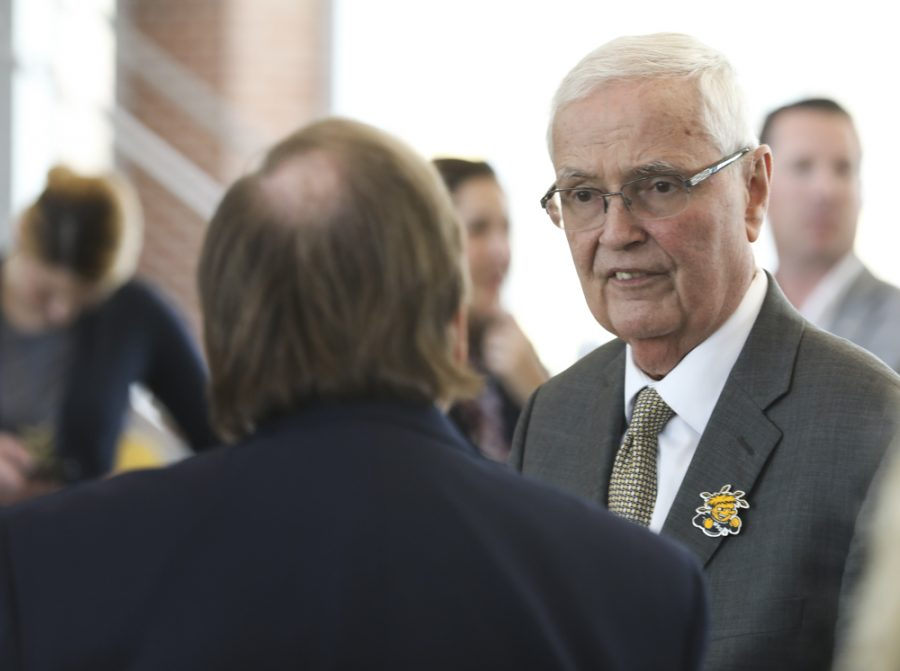 WSU President John Bardo talks to David Murfin of the Kansas Board of Regents at an event announcing a partnership building with Spirit AeroSystems  and Wichita State University.