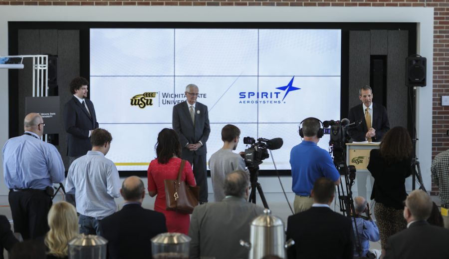 President and CEO of Spirit AeroSystems  Tom Gentile, right, speaks along side Wichita State President John Bardo, center, and Trevor Steinbrock, left, during an event announcing a partnership building with Spirit AeroSystems  and Wichita State University.