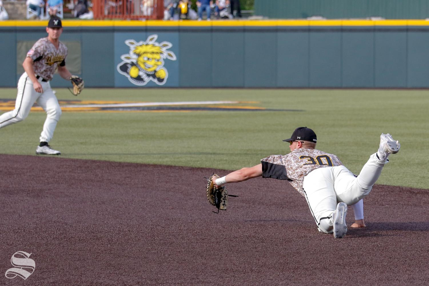 Wichita State's Greyson Jenista makes a diving catch at first during their game against ORU on May 8, 2018 at Eck Stadium.