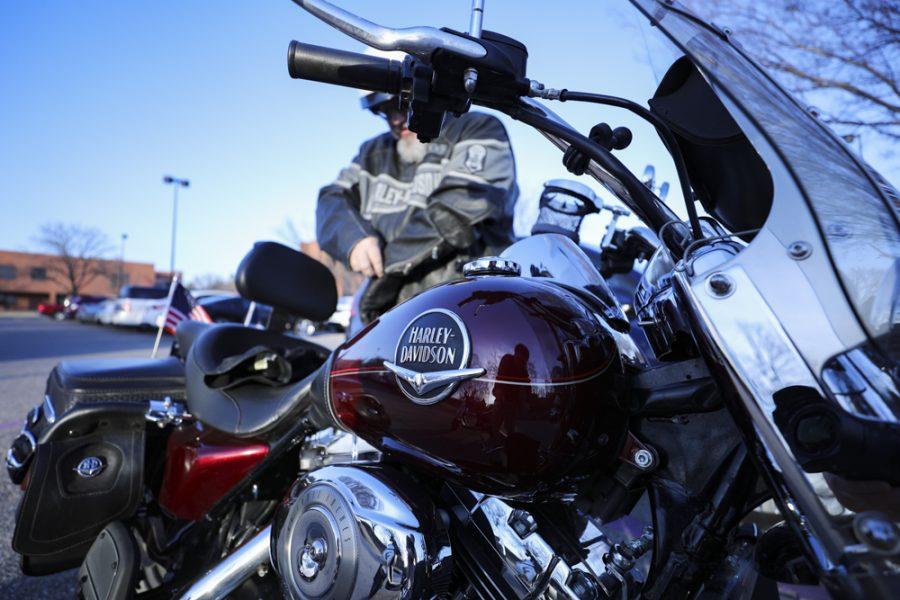 Bill Molash gets on his Harley Davidson after working in Elliott Hall.