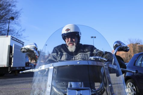 Bill Molash gets on his Harley Davidson after working in Elliott Hall.