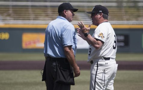 Wichita State Head Coach Todd Butler argues over a call made by the umpire during the third game of the series against Cincinnati Sunday afternoon.