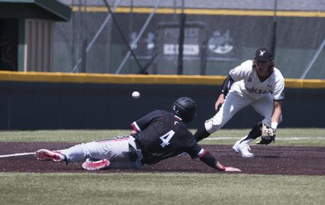 Wichita State's Alec Bohm catches a throw from catcher Gunnar Troutwine as a Cincinnati runner slides to third base.