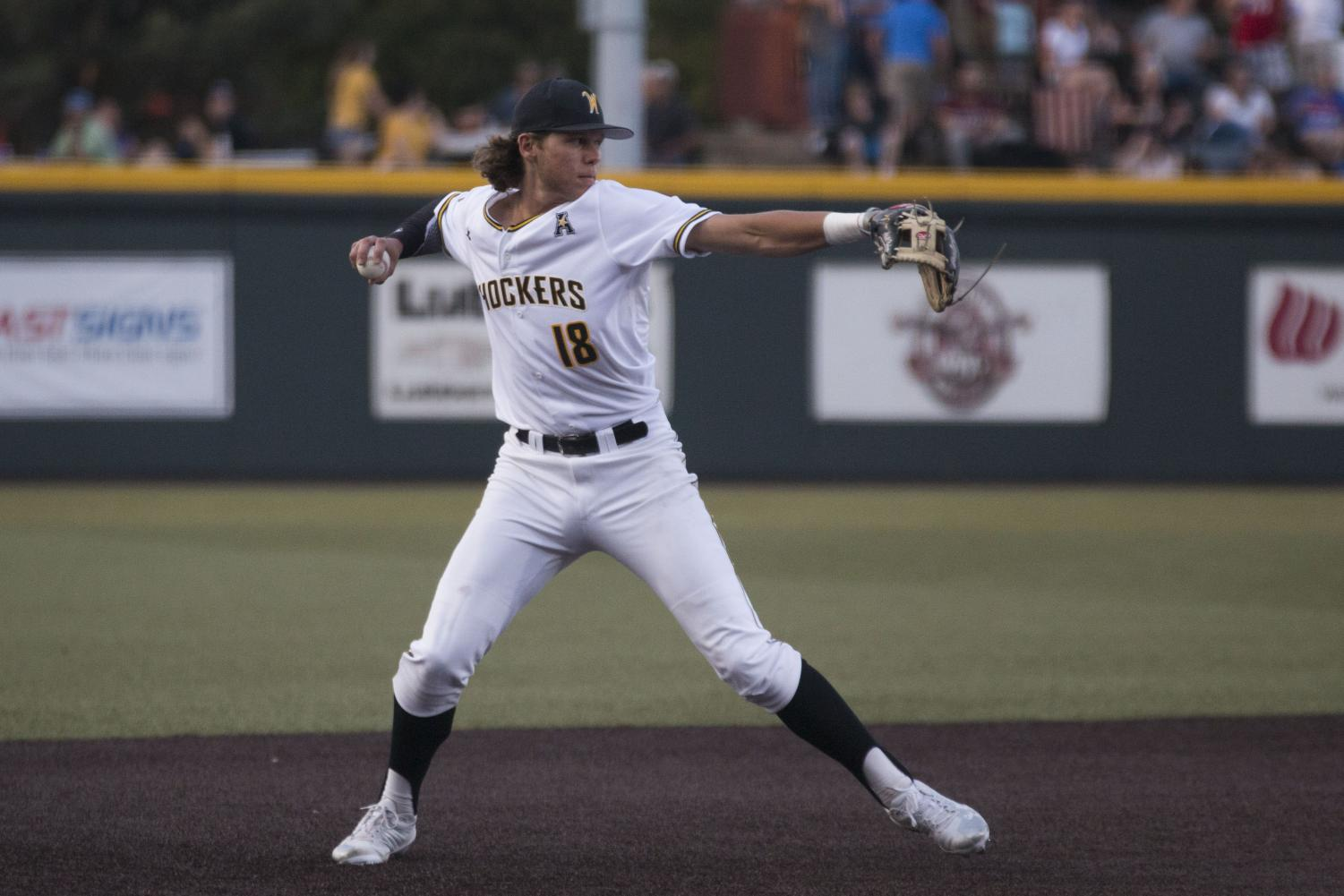 Wichita State junior Alec Bohm throws to first for an out against USF Friday evening at Eck Stadium.
