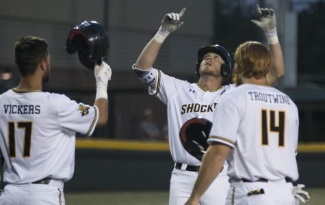 Wichita State's Greyson Jenista celebrates after hitting a home run against USF Friday evening during the first game of the weekend series at Eck Stadium.