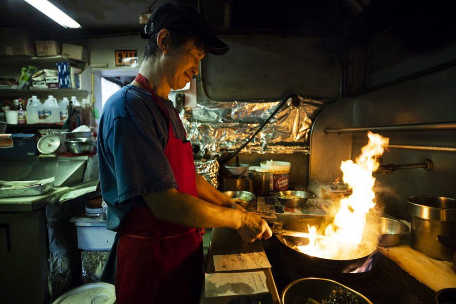 Yong-Chon cooks stir squid in the kitchen at Manna wok.