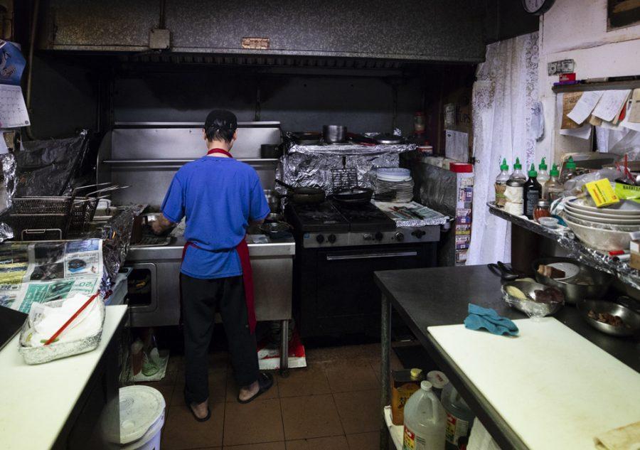Yong-Chon prepares stir squid in the kitchen at Manna wok.