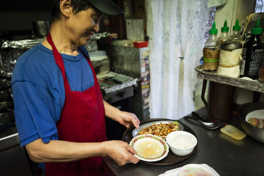 Yong-Chon prepares a tray of stir squid, rice and egg flower soup for a guest at Manna Wok.