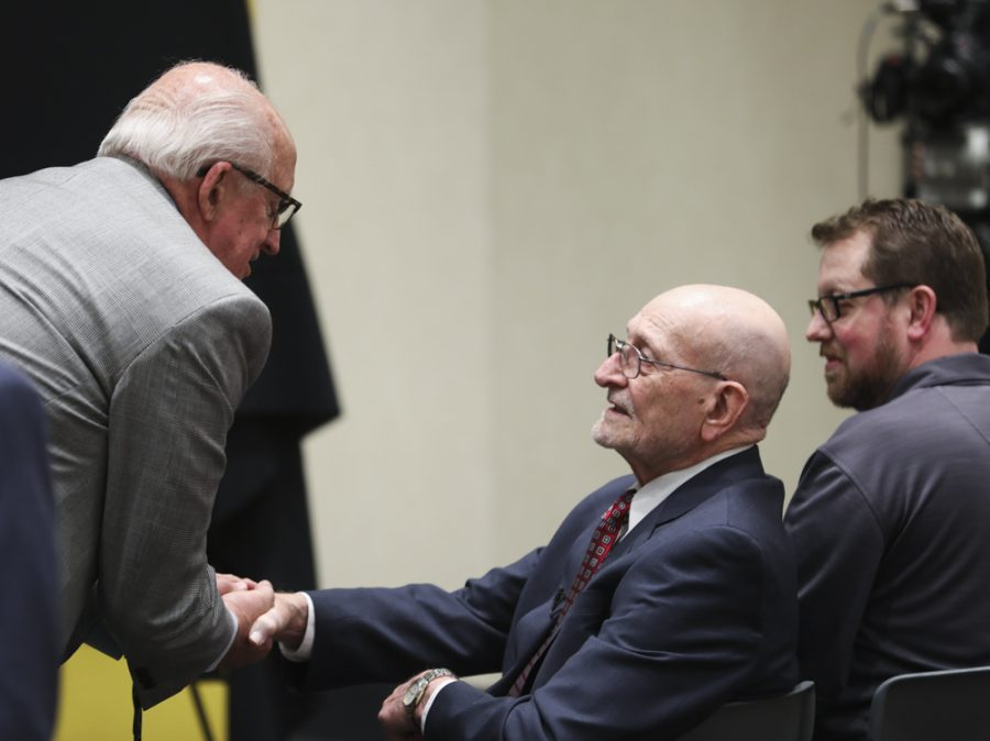 Dean of Liberal Arts and Science Ron Matson and Wayne Woolsey shake hands before a press conference announcing a $12 million cash gift to the university.