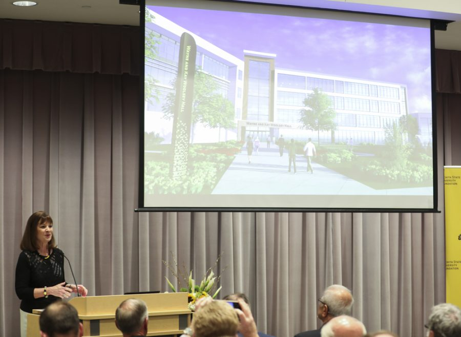 President and CEO of the WSU Foundation Elizabeth King introduces a rendering of the new Wayne and Kay Woolsey Hall. The new building will house the Frank Barton School of Business.