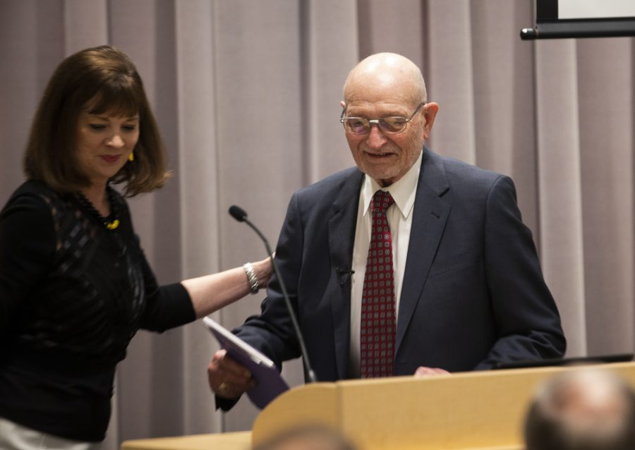 President and CEO of the WSU Foundation Elizabeth King helps Wayne Woolsey to the podium to address those in attendance for the announcement of the single largest cash gift to the university.