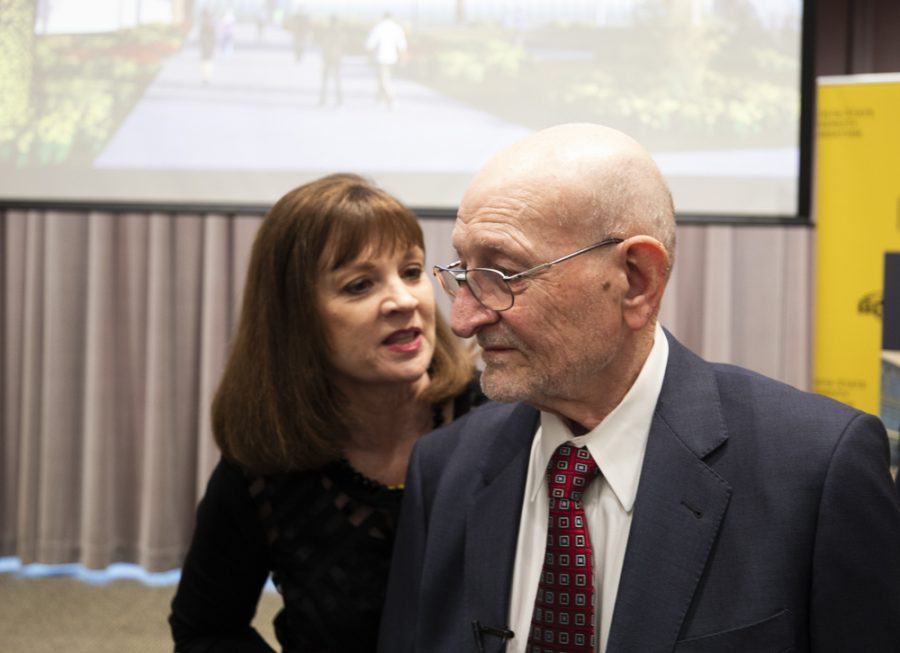 President and CEO of the WSU Foundation Elizabeth King talks to Wayne Woolsey after the announcement of the largest cash gift to the university and the WSU Foundation, made by Woolsey.