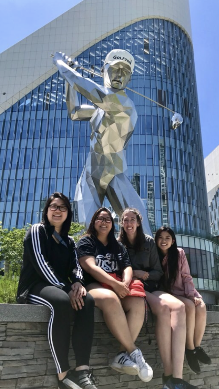 Wichita State students (left to right) Christina Cao, Theresa Doan, Lorryn McGuire, and Claudia Nguyen pose outside after after watching part of the Lotte Rent a Car Women's GolfZon Tour virtual professional golf tournament in Daejeon, South Korea.