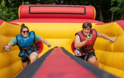 Courteney Castle (left) and Gabe Robertson (right) compete on a blow up at the Back to School Bash on August 18, 2018.