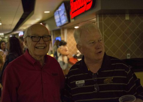 Freddy Simon interacts with Gordon Vadakin, head coach of the WSU bowling team, at the soft-opening of Freddy's Frozen Custard & Steakburgers at Wichita State. The location is in the Rhatigan Student Center.