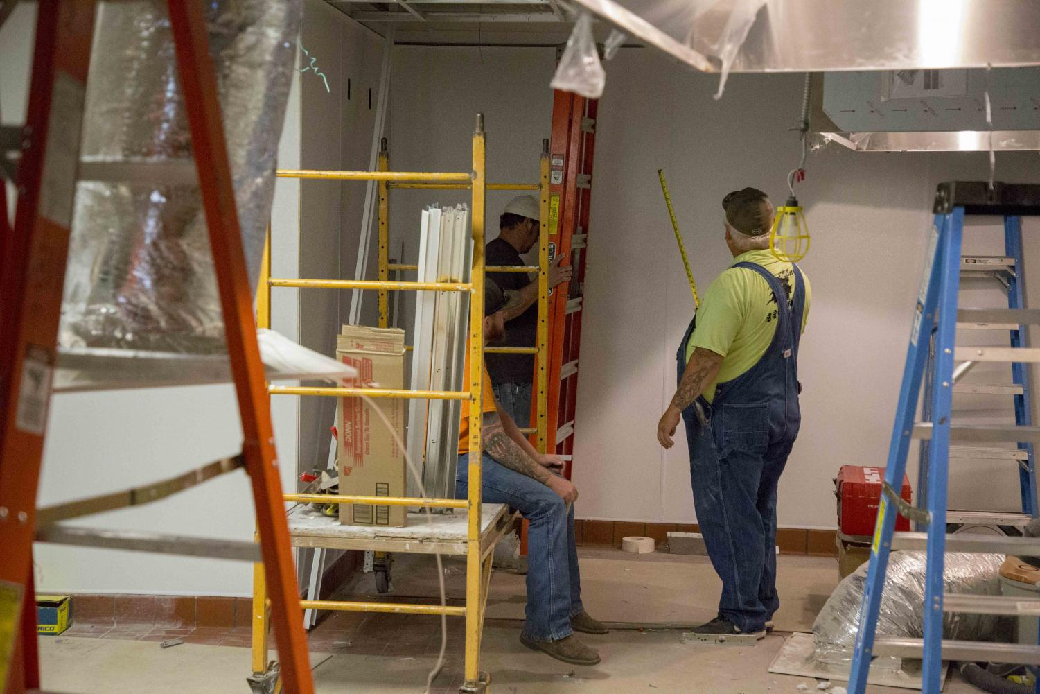 Contract workers work on transforming the former space of Mondo Subs to Freddy's Frozen Custard and Steakburgers. Freddy's is expected to open the first day of the fall semester, Aug. 20.