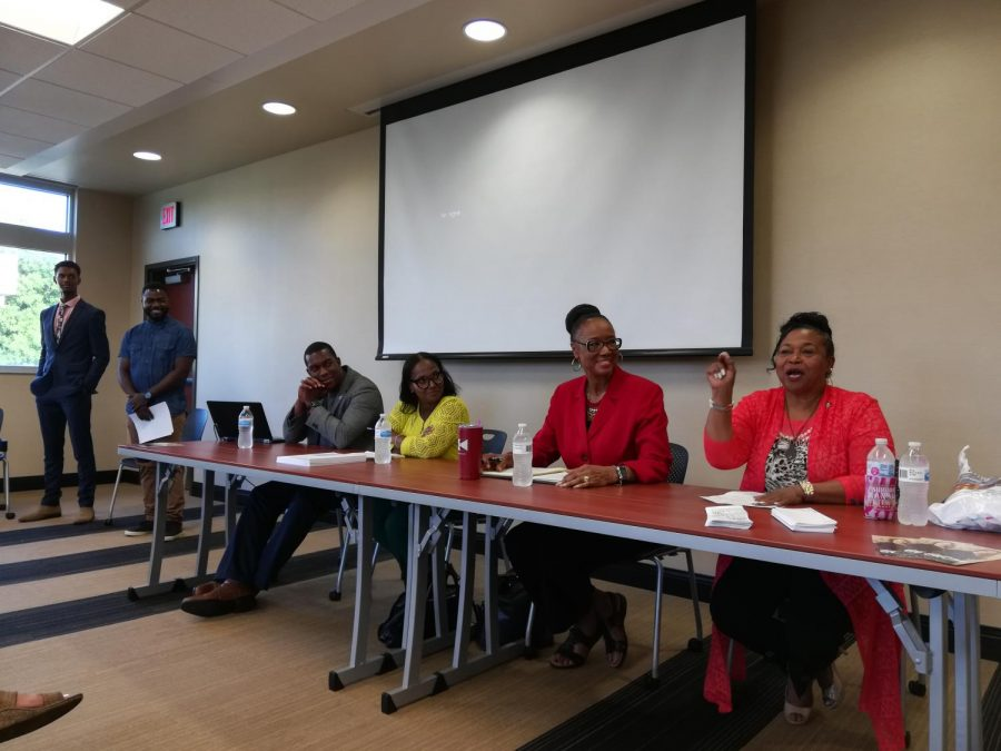 Panelists and organizers grin as Oletha Faust Goudeau (State Senator 29th District) shares an anecdote about her experience in the legislature.