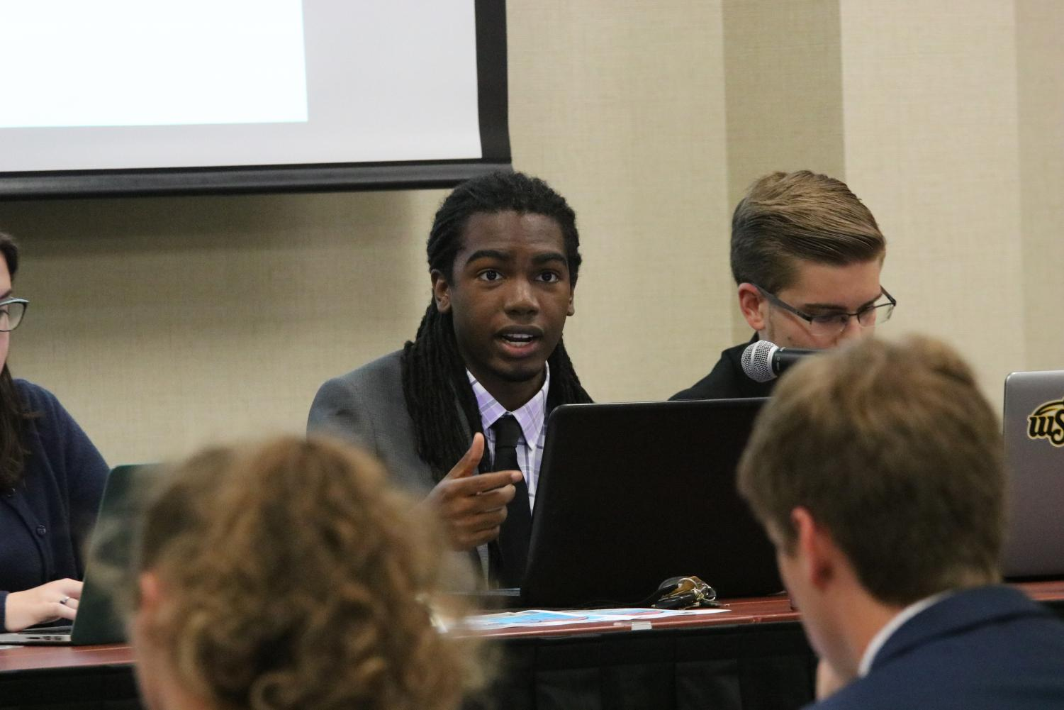 Student Body President Kenon Brinkley speaks during Wednesday's SGA meeting.