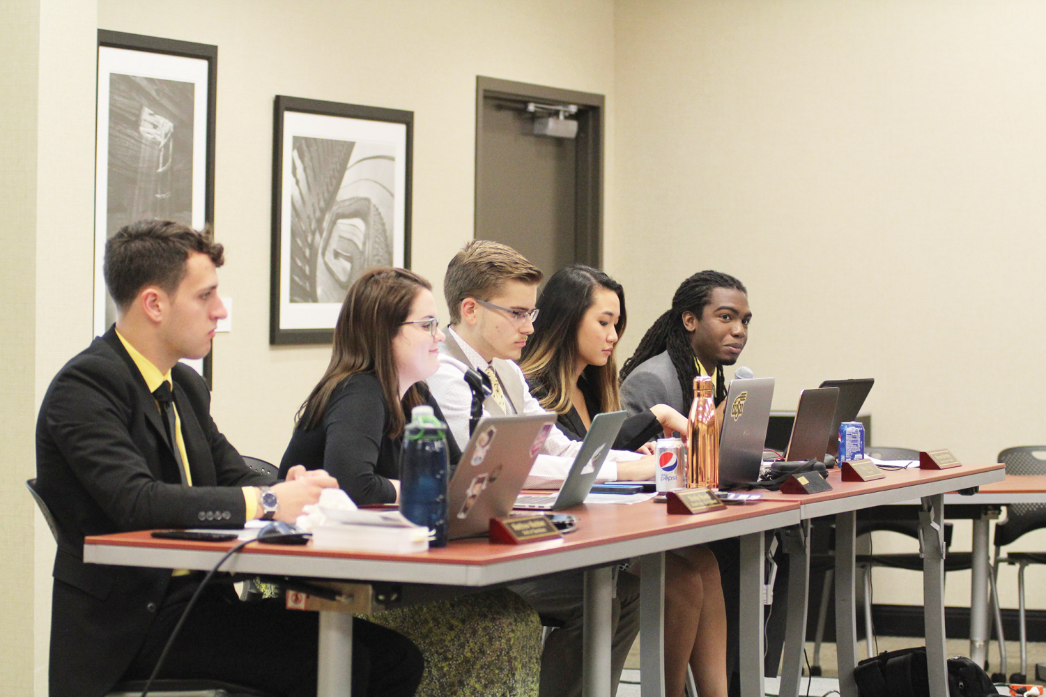 The SGA cabinet gives their officer reports during the first session Wednesday, Aug. 22.