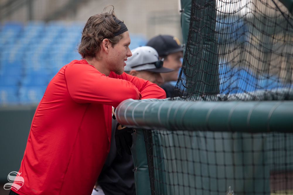 Alec Bohm, drafted 3rd overall by the Philadelphia Phillies in the 2018 MLB Draft, watches WSU Baseball practice at Eck Stadium on Sep. 8, 2018. Bohm is seen next to Assistant Coach Sammy Esposito and Volunteer Assitant Coach Willie Schwanke.