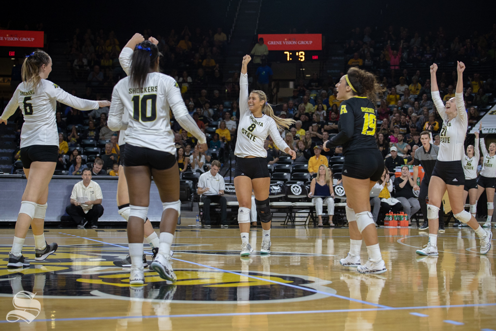 The+Shockers+celebrate+after+winning+a+point+during+their+game+against+Tulane+on+Friday+evening+at+Koch+Arena.+%28Sept.+21%2C+2018%29