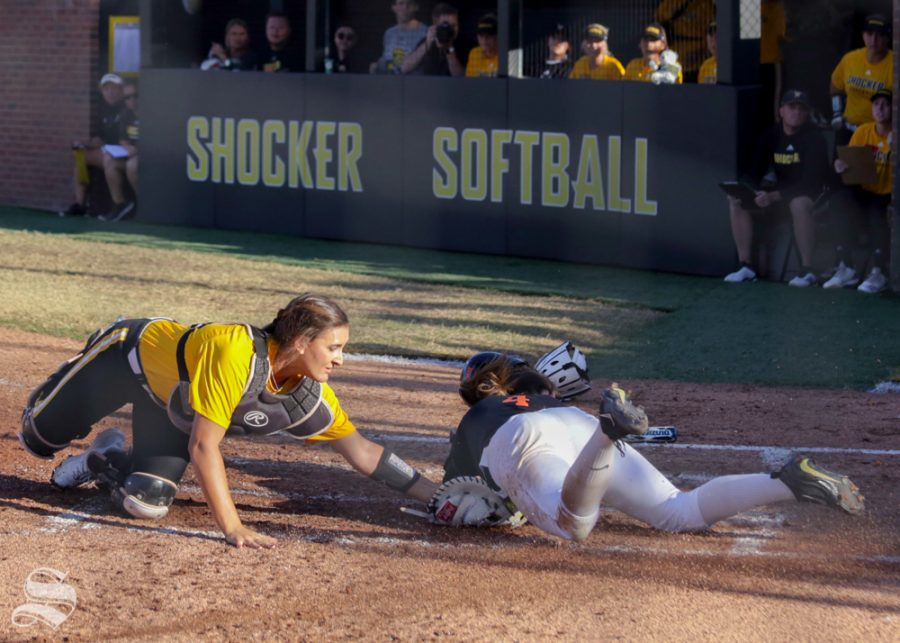 Wichita State catcher Madison Perrigan tags out an Oklahoma State runner at home plate. Wichita State lost to Oklahoma State on the game held Sept. 27, 2018 at Wilkins Stadium.
