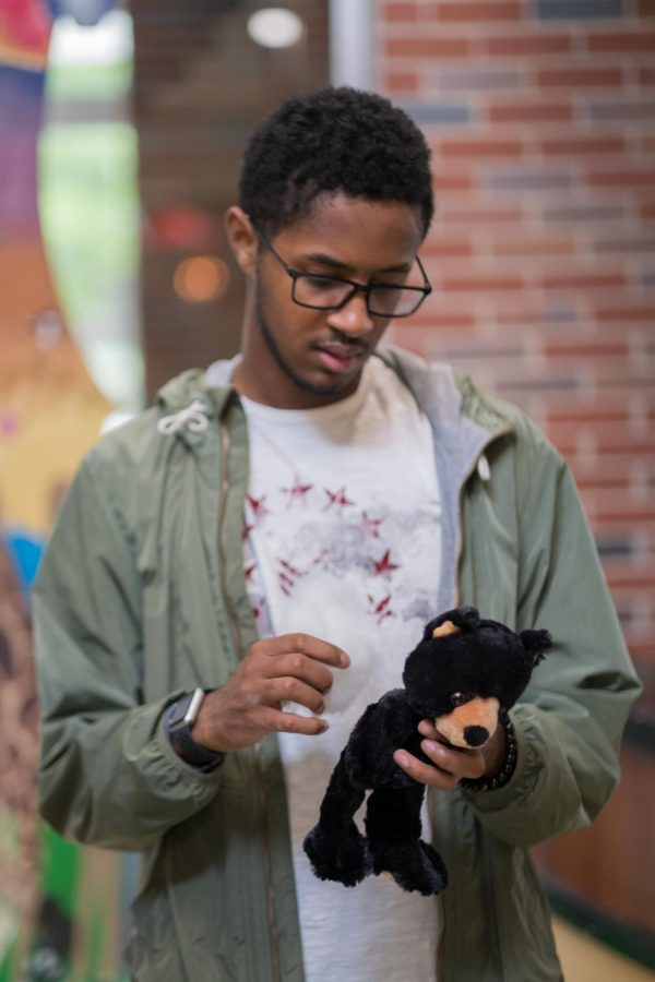 Payton Morgan, a junior majoring in Computer Science, fills a Teddy bear with cotton wool.