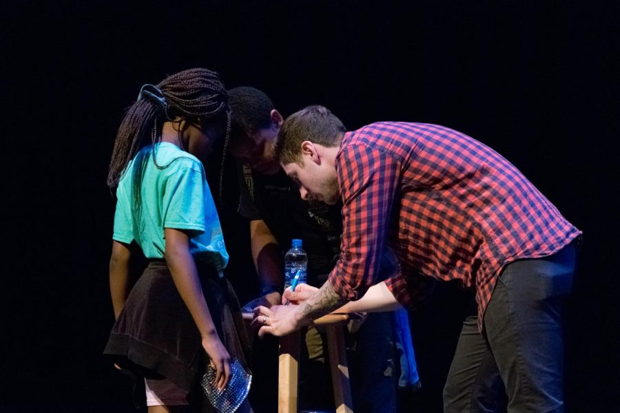Samuel J Comroe interacts with children and give them his signature after the show.