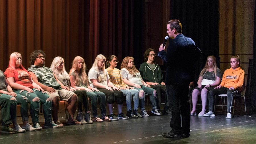 David Hall asks WSU students to come on the stage to be part of the show. He told participants to close their eyes and started hypnotizing them.