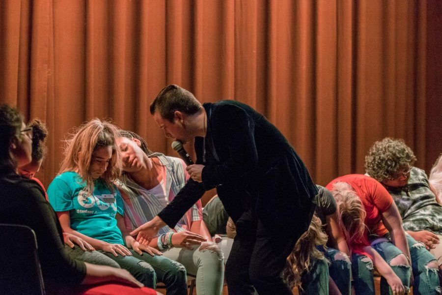 David Hall hypnotizes the participants one by one by putting them to sleep.