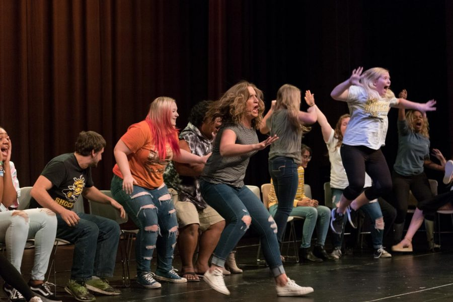 Participants scream with joy as theyre hypnotized that they win a million dollar jackpot at the casino in Las Vegas.