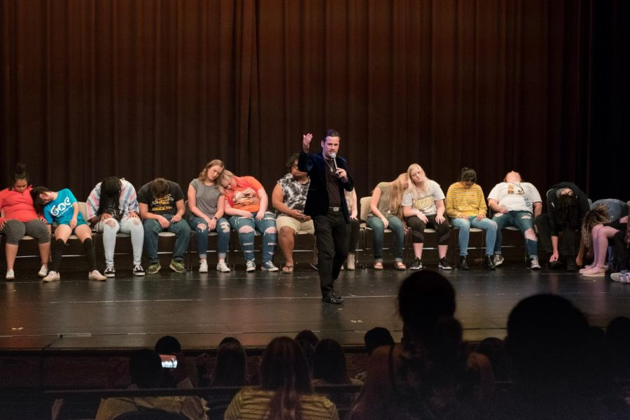 David Hall performs along with WSU students in front of the audience.