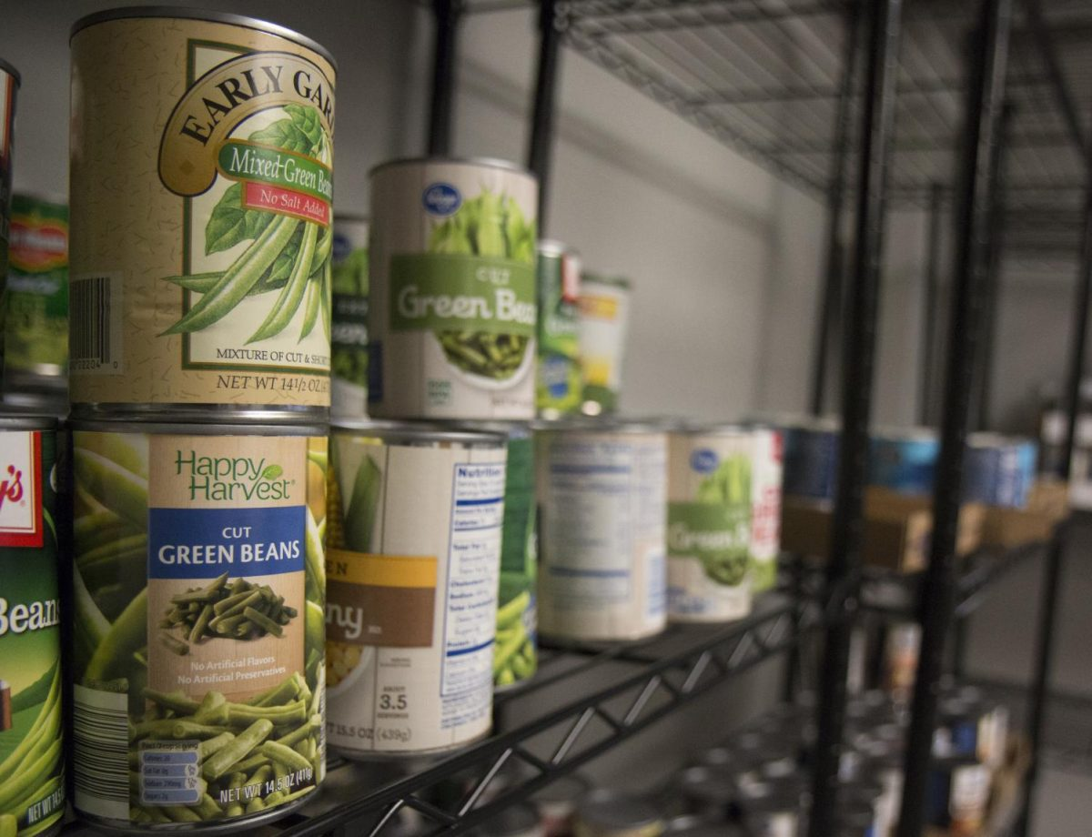 Cans of green beans sit on a shelf in the Shocker Support Locker.