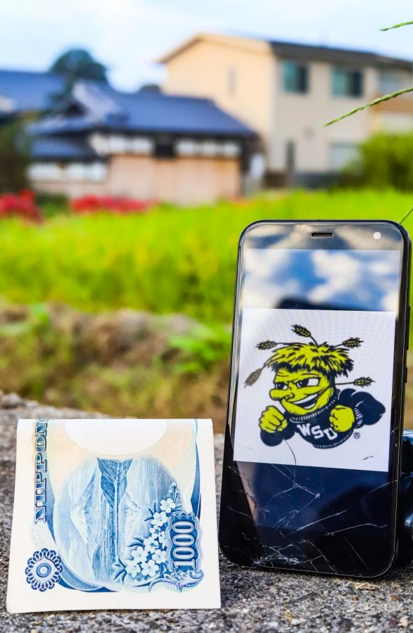A students cell phone and 1,000 yen worth of lunch cash sit nestled among a Katano City rice paddy field. This past Sunday, September 23. Japanese students at WSU sister school Kansai Gaidai University in Osaka, Japan shared their thoughts on what they thought Wu-Shock ooks like.